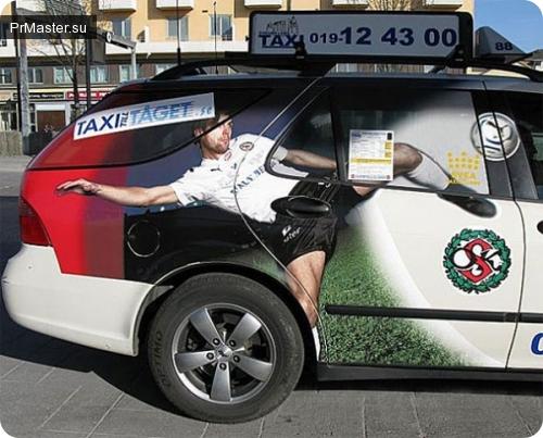 Пример неудачного расположения рекламы на авто